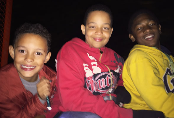 Crossroads Kids campers enjoyed a hayride at night! Hayrides and other camp activities promote a bond of friendship between children experiencing grief.
