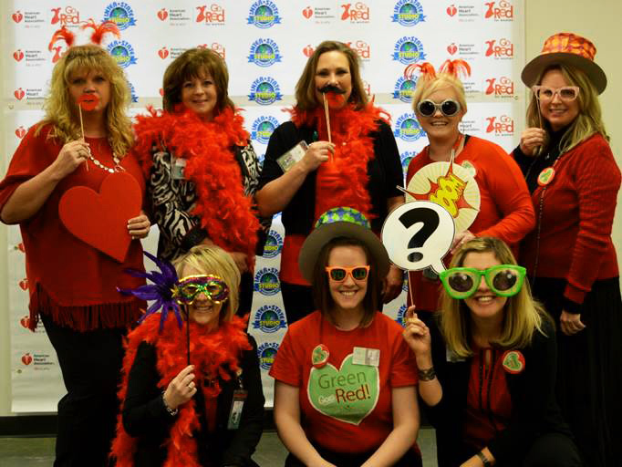 The Crossroads Hospice Charitable Foundation team showing that happy heart is a healthy heart at the 2016 Go Red for Women Luncheon in Sedalia, Missouri.