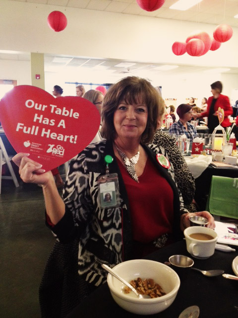 Crossroads Hospice's Janet Hessenflow shows off our table's 'Full Heart'-level sponsorship.