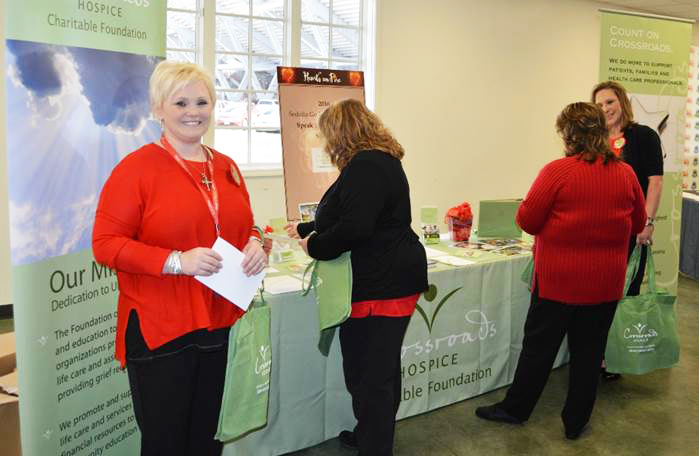 Crossroads Hospice Charitable Foundation staff prepares to hand out information and discuss end-of-life care options with the attendees of the 2016 Go Red for Women Luncheon in Sedalia, Missouri.